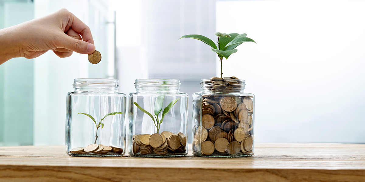 Jars of change with plants growing out of them