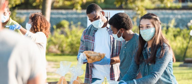 People volunteering at an outdoor food bank