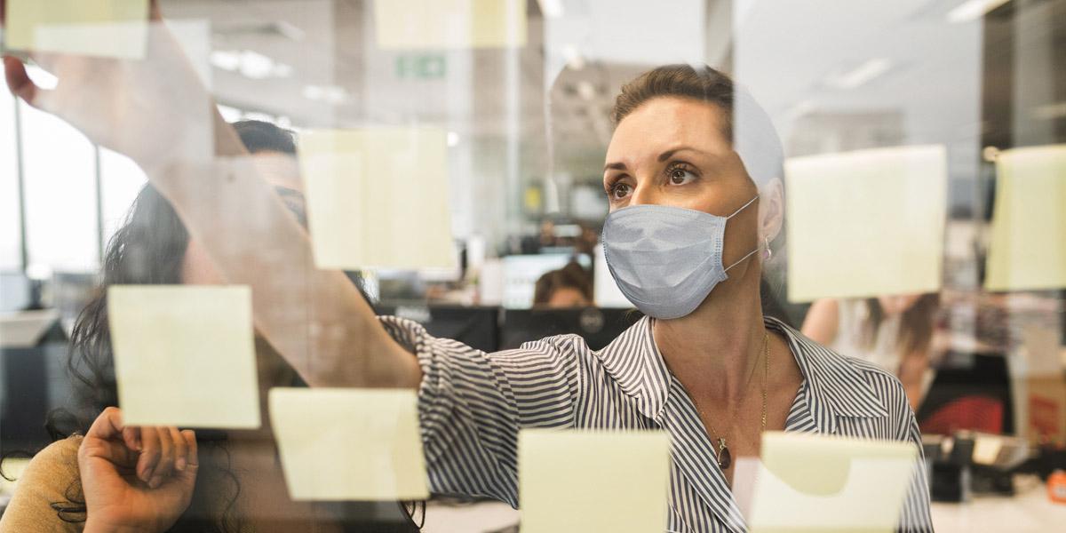 Businesswomen Working with Masks On