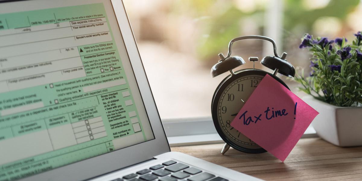 Tax Time Sticky Note On Alarm Clock