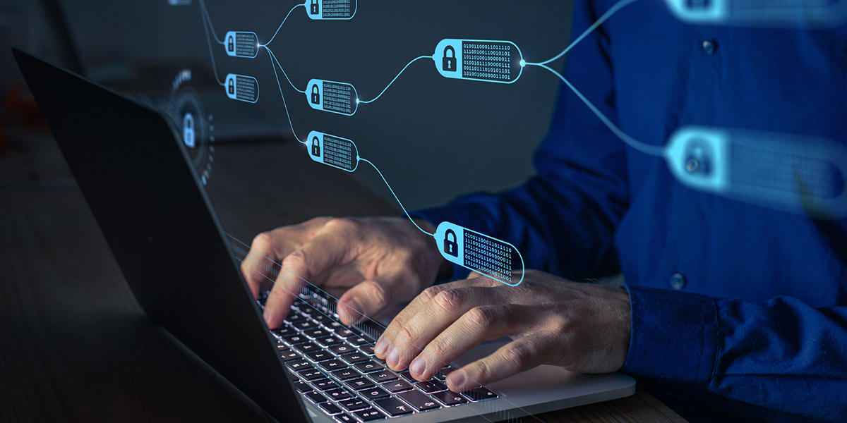 man at computer with lock icons floating up
